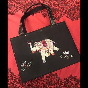 Adorable black fabric bag with jeweled elephant